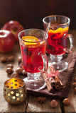 Glass of mulled wine with orange and spices, christmas decoratio Stock Photo
