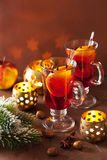 Glass of mulled wine with orange and spices, christmas decoratio Royalty Free Stock Photos