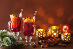 Glass of mulled wine with orange and spices, christmas decoratio Stock Photos