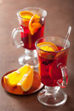 Glass of mulled wine with orange and spices, winter drink Royalty Free Stock Photo
