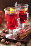 Glass of mulled wine with orange and spices, winter drink Stock Images