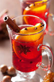 Glass of mulled wine with orange and spices, winter drink Stock Image
