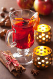 Glass of mulled wine with orange and spices, winter drink Royalty Free Stock Image