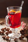 Glass of mulled wine with orange and spices, winter drink Stock Photography