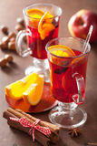 Glass of mulled wine with orange and spices, winter drink Stock Photo