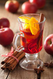 Glass of mulled wine with orange and spices, winter drink Royalty Free Stock Images