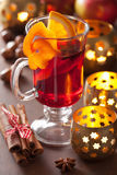Glass of mulled wine with orange and spices, winter drink Royalty Free Stock Photography
