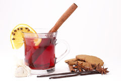 Glass of mulled wine with pepper cookies. Christmas drink Stock Images