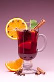 Glass of mulled wine on a pink. Stock Photography