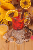 Glass of mulled wine with scarf Royalty Free Stock Photography