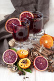 Glass with mulled wine and spices Royalty Free Stock Images
