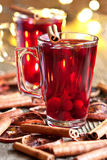 Glass with mulled wine and spices Royalty Free Stock Photo
