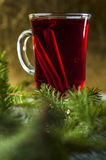 Glass of mulled wine with spices Stock Photos