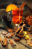 Glass with mulled wine and spices Royalty Free Stock Photography