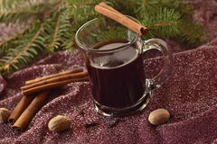Glass with mulled wine and spices Stock Photo