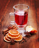 Glass of mulled wine on the table in dark wood. The dried oranges, anise and cinnamon Royalty Free Stock Photos