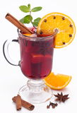 Glass of mulled wine on a white. Royalty Free Stock Photos
