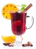 Glass of mulled wine on a white. Royalty Free Stock Image