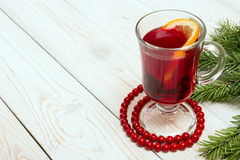 Glass of mulled wine on white wooden table. royalty free stock images