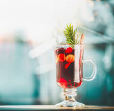 Glass of mulled wine at winter day background, front view Royalty Free Stock Photography