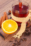 Glass of mulled wine wrapped scarf with fresh fragrant spices Royalty Free Stock Images