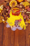 Glass of mulled wine in yellow scarf Royalty Free Stock Images