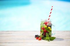 Glass of natural berry lemonade royalty free stock photo