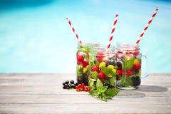 Glass of natural berry lemonade stock photos