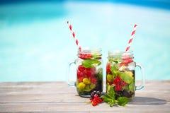 Glass of natural berry lemonade stock photo
