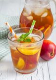 Glass of nectarine iced tea Stock Image