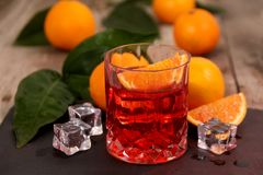 A glass of Negroni cocktail with Campari, Vermouth, Gin and Oranges. royalty free stock photo