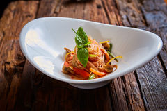 Glass noodles with mushrooms and vegetables. Royalty Free Stock Images