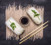 Glass noodles with soy sauce and chopsticks  wooden rustic background top view close up Royalty Free Stock Photography