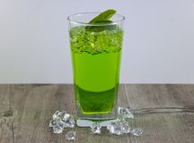 A glass of nutritious estragon drink to maintain a healthy lifestyle. Were added to the drink ice royalty free stock image