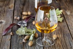 Glass oа amber color whisky in glass on oak table royalty free stock photo