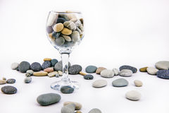 Glass with ocean rocks on white background Royalty Free Stock Photos
