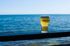 Glass Of Beer Against Sea Stock Images