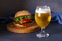 Glass Of Beer And Burger. Beer And Food Concept. Royalty Free Stock Photos