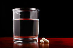 Free Glass Of Clear Water And Pills On Dark Royalty Free Stock Photo - 17879975