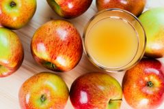 Glass Of Fresh Apple Cider Near Autumn Apples Royalty Free Stock Photography