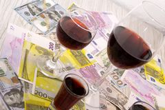 Free Glass Of Red Wine And Money On An Old Wooden Table. Angle View, Focus On The Glass Of Red Wine Royalty Free Stock Photo - 132515925