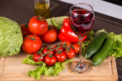 Glass Of Red Wine Near Fresh Vegetables Royalty Free Stock Photos