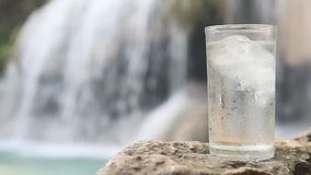 Glass Of Water With A Waterfall Royalty Free Stock Photos