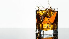 Free Glass Of Whiskey Or Brandy. Splash In A Glass On White Background. Alcohol Drink. Clear Ice In Cube Shape. Stock Image - 214951981