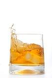 Glass Of Whiskey With Ice Cubes Splashing Royalty Free Stock Photos