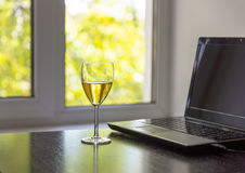 Glass Of White Wine And Laptop Royalty Free Stock Images