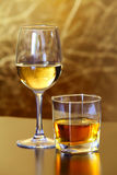 Glass Of White Wine And Whiskey Stock Photos