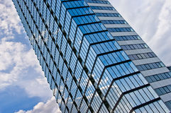 Glass office building. A tall, glass office building Royalty Free Stock Image