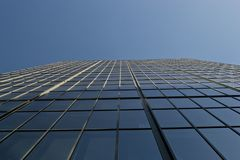 Glass office building bottom-up view stock image