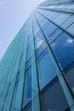 Glass office building with clouds reflection Royalty Free Stock Photo